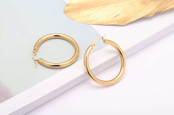 Fashion Stainless Steel Round Glossy Hollow Earrings
