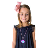 Girl wearing purple Munchables Butterfly Chew Necklace.