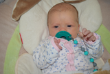 Baby Girl with binky on Munchables Pacifier Clip