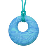 Munchables Aqua Scribbles Chew Necklace features wavy lines of shades of aqua and is strung on an aqua cord.