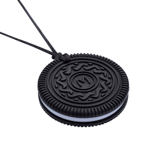 Munchables OREO-like Chew Necklace on Black featuring an M in the center and a white middle section.