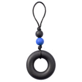 This Munchables Chewy Zipper Pull features a large black  donut bead and 2 smaller beads strung on a grey cord.