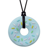 Munchables Blue Donut Chew Necklace with Colourful Sprinkles Strung on a Black Cord.