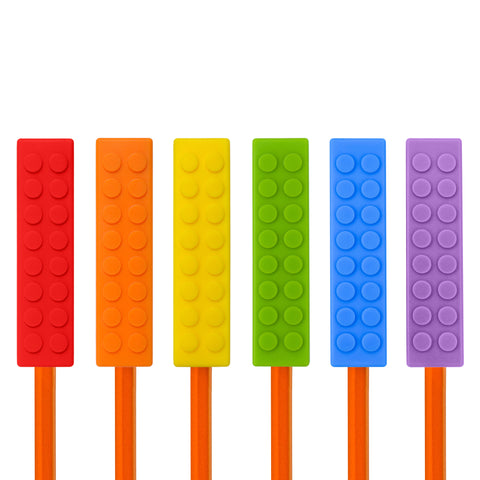 Set of 6 Munchables rainbow coloured LEGO shaped chewable pencil toppers. Red, Orange, Yellow, Green, Blue, Purple. Fits on Size #2 pencils and pens.