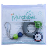 A Munchables Chewable Zipper Pull in its reuseable package.