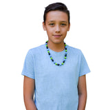 This Munchables Beaded Chew Necklace with black, green and blue round beads is worn by a teen boy.