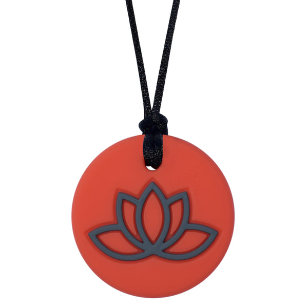 Munchables Lotus Chew Necklace with Coral Background and Gray Design.