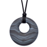 Munchables Gray Scribbles Chew Necklace features wavy lines of grays and blacks and is strung on a black cord.