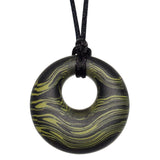 Munchables Green Scribbles Chew Necklace features wavy lines of dark green and black and is strung on a black cord.