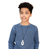A teenager wears the Munchables Bone Coloured Fish Hook Chew Necklace.