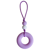This Munchables Chewy Zipper Pull features a large purple donut bead and 2 smaller beads strung on a grey cord.