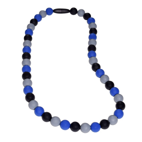 Munchables Midnight Blues Chew Necklace features black, gray and navy blue repeating beads and a black breakaway clasp.