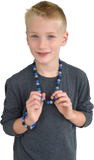 Munchables Midnight Blues Chew Necklace worn by a boy.