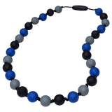 Munchables Camo Sensory Chew Necklaces feature smooth, round silicone beads in black, grey and navy blue strung on a nylon cord with knots between each bead.