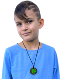 Munchables Green Black Ninja Star Chew Necklace worn by a teen boy.
