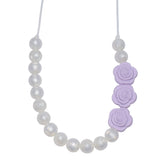 The Munchables Pearl Chew Necklace features pearl beads on only half the necklace and 3 lavender rose beads.