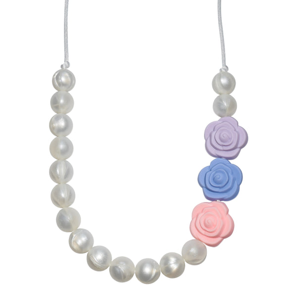 The Munchables Pearl Chew Necklace features pearl beads on only half the necklace and a lavender, blue and pink rose