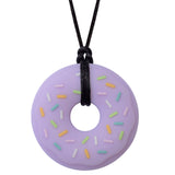 Munchables Purple Donut Chew Necklace with Colourful Sprinkles Strung on a Black Cord.