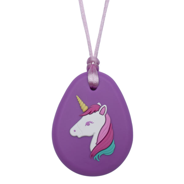 Munchables Purple Unicorn Chew Necklace features a white unicorn with a three coloured mane, a purple eye and a yellow horn strung on a light purple cord.