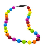 Munchables Rainbow Chew Necklace features 6 different coloured repeating round beads strung on a black cord with knots between each bead.