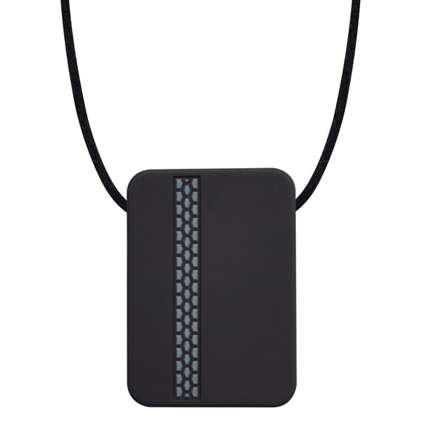 The Munchables Rectangle Teen Chew Necklace is a discreet black rectangle with slightly rounded edges and a coloured tire track design on the front side. It is strung on a black cord.
