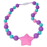 Munchables Starlight Chew Necklaces feature aqua, purple and pink beads in two sizes and a large pink star.