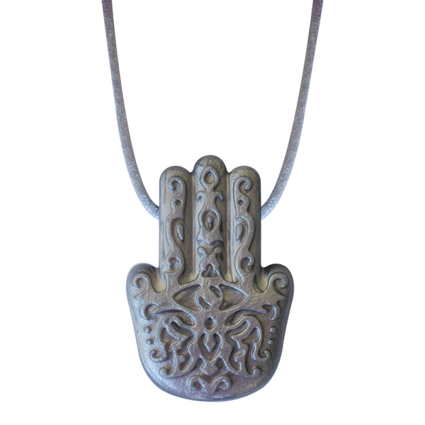 The Munchables Silver Hasma Hand Chew Necklace is a middle-eastern inspired design