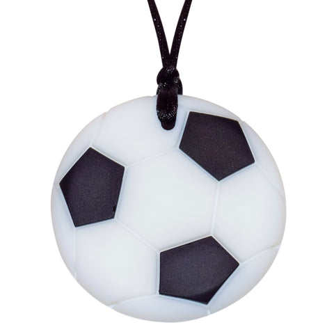 Munchables Soccer Chew Necklace in black and white strung on a black cord.