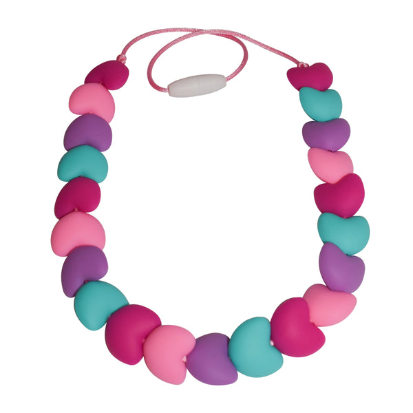 The Munchables Sweetheart Sensory Chew Necklace features our smooth, heart-shaped beads.