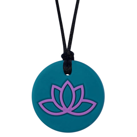 Munchables Lotus Chew Necklace with Teal Background and Purple Design.