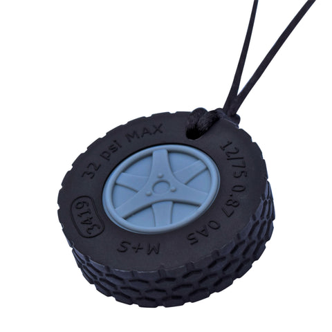 Munchables Tire Chew Necklace features black rubber and a grey hubcap.