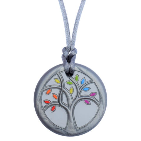 Munchables Tree of Life Chew Necklace is all silver except for red, orange, yellow, green, blue and purple leaves. It is strung on a gray cord with breakaway clasp.