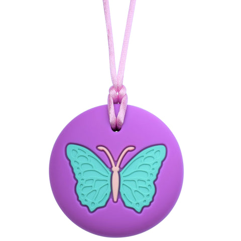The Munchables Butterfly Chewable Necklace features a large light blue butterfly on a purple background strung on a purple nylon cord with breakaway clasp.