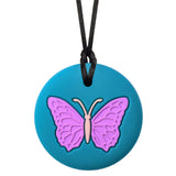 The Munchables Butterfly Chewable Necklace features a purple butterfly on a teal background strung on a black nylon cord with breakaway clasp.