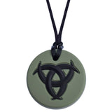Munchables Celtic Chew Necklace with dark green background and a black raised design.