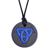 Munchables Celtic Chew Necklace with a black background and a blue raised design.