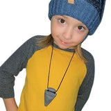 Munchables Arrowhead Sensory Chew Necklaces worn by young boy.