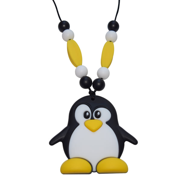 Munchables Mr. Penguin Chew Necklace in yellow, black and white. Features beads on either side of the black cord that it is strung on.