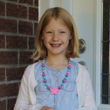 Girl Wearing Munchables Starlight Chew Necklace.