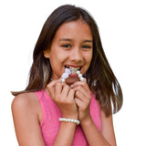 Teen girl wearing Munchables Pearl Chew Bracelet and Pearl with Roses Necklace.