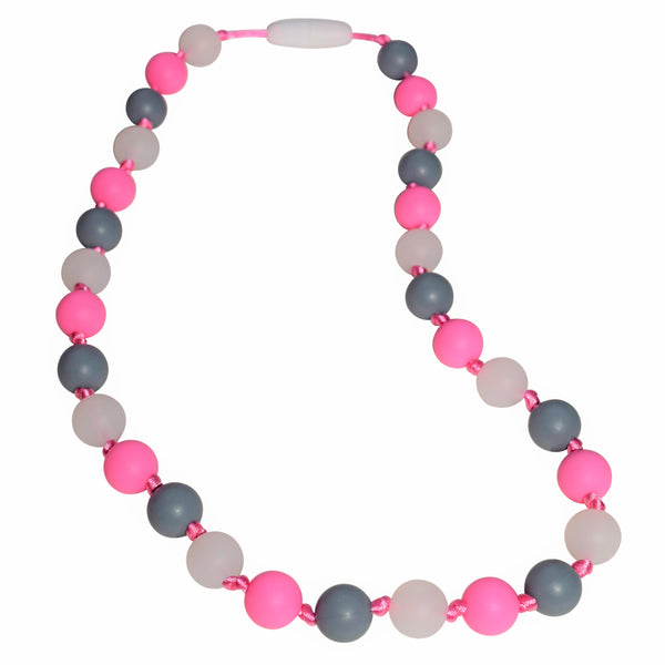 The Munchables Glow-in-the-Dark Necklace features glow, gray and pink chewable beads