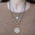 VINTAGE SILVER MINI COIN AND HORSEBIT NECKLACE