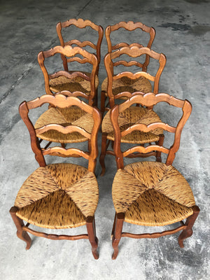 Set of six French Louis XV style rush seated dining chairs