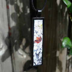 """The Beauty of Letting Go"" Pendants by Doe Zantamata"