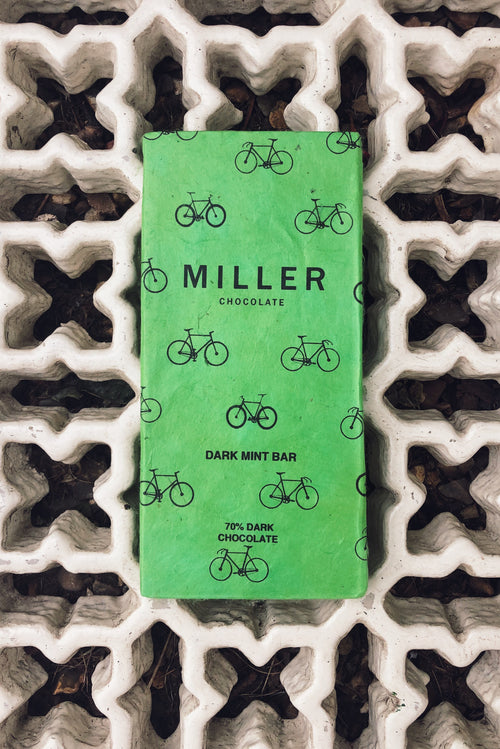 Dark Mint Chocolate with cocoa nibs for a little crunch. a 70% refreshing dark by Nathan Miller Chocolate with a fun bike print in green.