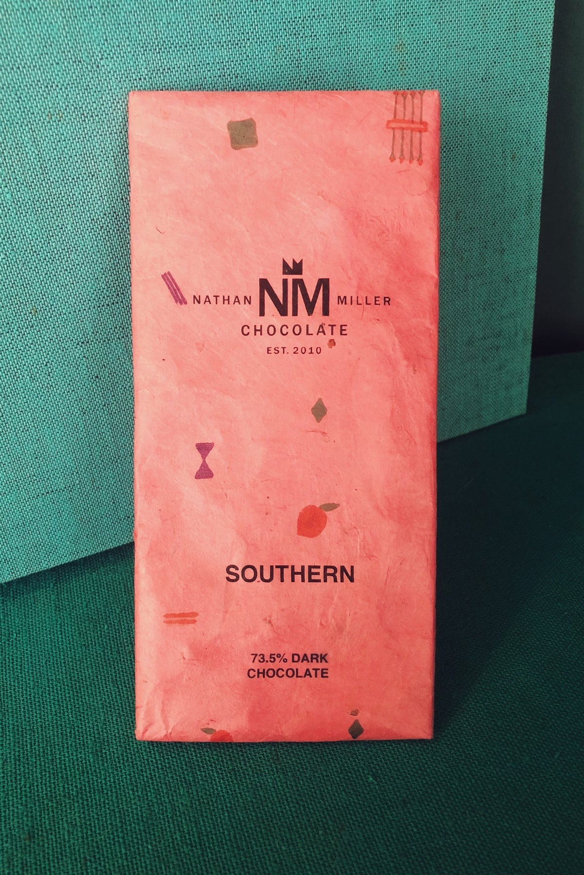 Southern bar by Nathan Miller Chocolate a Bean to Bar Chocolate Company based a few miles from the Mason Dixon line in Pennsylvania. Bourbon Peach Dark Chocolate, Honey Pecans, Blackberry.