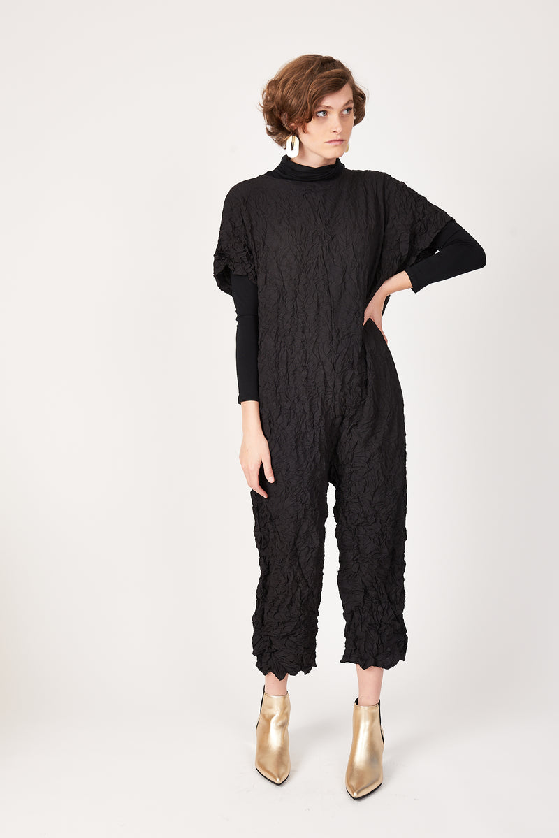 black short sleeve jumpsuit in Xanadu