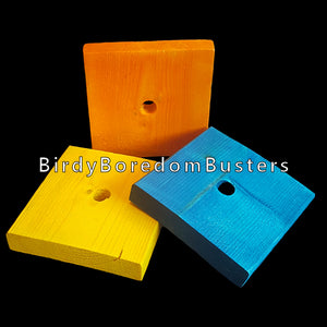 "Brightly colored softwood (pine) blocks measuring 3-1/2"" by 3-1/2"" by 5/8"" thick with a 1/2"" center hole. Recommended for medium to large birds or as a toy base."