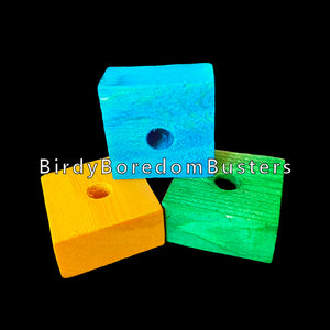 "Brightly colored pine wood blocks measuring 1-1/2"" by 1-1/2"" by 3/4"" thick with a 3/8"" center hole. Recommended for medium to large sized birds.  Package contains 30 pieces in assorted colors."