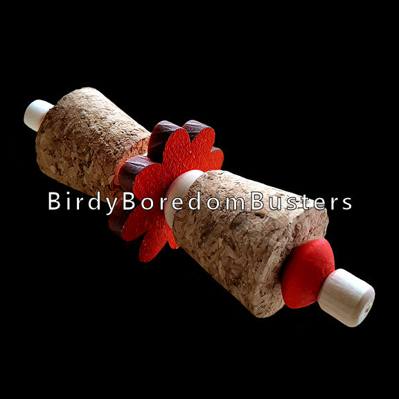 Chubby corks, wood beads and a brightly colored pine daisy make up this foot toy designed for intermediate or medium sized birds that like softer textures.  Measures approx 4-1/2